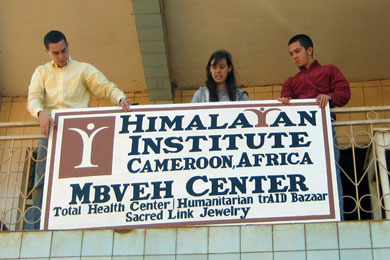 John Daskovsky, Chelsea Abella, and Rylan Grady hang the sign for the new Mbveh Center