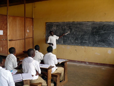 Devin, 24, solves a problem in front of the class. He hopes to attend university in Yaoundé and become a civil engineer.
