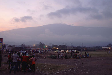 The King of Mountains: At sunset the night before the race, the winds shift and reveal Mount Cameroon to the onlookers in Molyko stadium. The true summit is on the opposite side of the mountain.