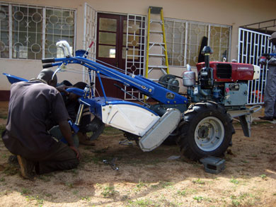 Assembling one of the tillers.