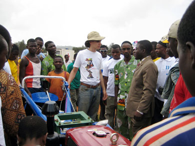 HIC volunteer John Daskovsky tells a group of onlookers about the new tractors. The tractors will be available to the community through a service rental program, which will enable farmers to cultivate more land with greater ease.