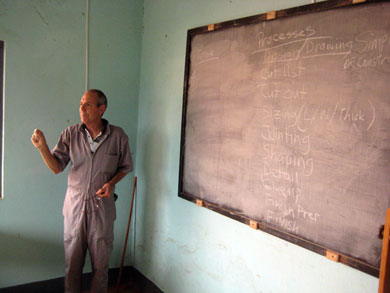 HIC volunteer Marten Nyar gives the first lecture of the class.