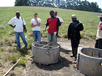 Energy Farming technician Collins Litika describes how the concrete rings are cast. Once the well was dug, the entire length was lined with concrete rings to strengthen the well and prevent soil from entering the water.
